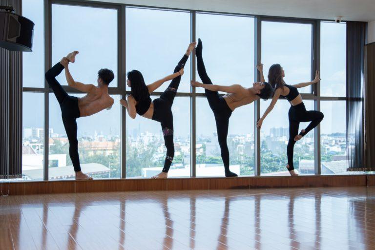 Anonymous dancers near window