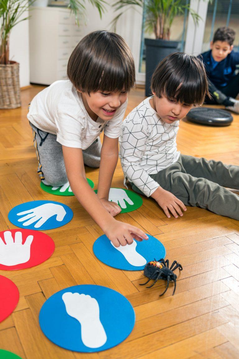 children-playing-with-toy-spider-in-a-kindergarten.jpg