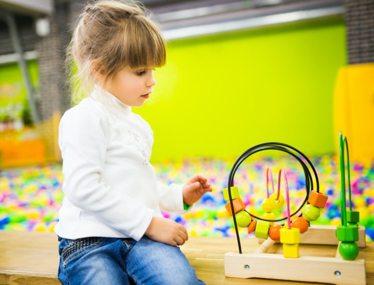 girl-playing-with-a-developmental-toy.jpg