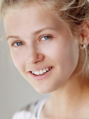 Portrait of smiling blond woman.