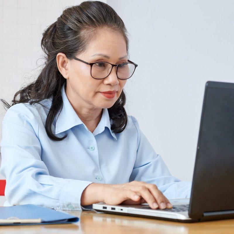 school-teacher-working-on-laptop.jpg