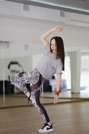 Young modern dancer dancing in the studio